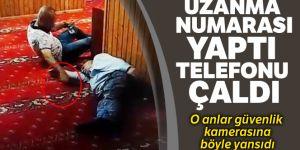 Camide uyuyan şahsın yanına uzanma numarası yapıp telefonunu çaldı