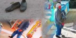Market kirlenmesin diye çamurlu ayakkabılarını çıkarıp çoraplarıyla içeri girdi